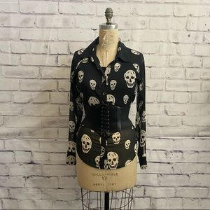 Black high/low top with white skulls all over it